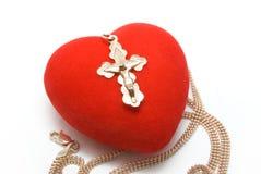 Corazón con una cruz Fotografía de archivo libre de regalías