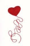 Corazón con una cuerda de rosca foto de archivo