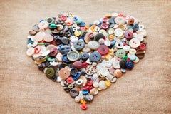 Corazón de costura de los botones Fotos de archivo libres de regalías