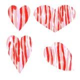 Corazón de cuatro diverso formas con diseño de la raya en colores rojo-rosados Imagenes de archivo