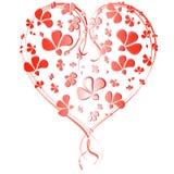 Corazón de flores rojas pequeñas y grandes Imagenes de archivo