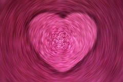 Corazón de giro y que remolina del rosa de la falta de definición de movimiento Foto de archivo libre de regalías