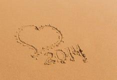 Corazón de la arena 2014 años Foto de archivo libre de regalías