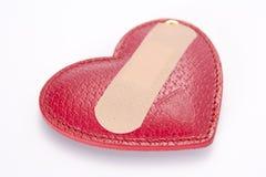 Corazón de la cubierta de la ayuda de venda Foto de archivo libre de regalías