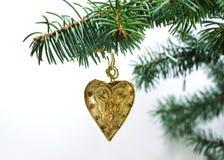 Corazón de la Navidad del tejido del oro Imagenes de archivo