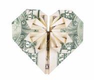 Corazón de la papiroflexia del dólar Papiroflexia del dinero El dólar dobló en el corazón aislado en el fondo blanco Foto de archivo libre de regalías