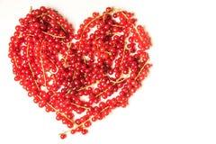 Corazón de la pasa roja Imagenes de archivo