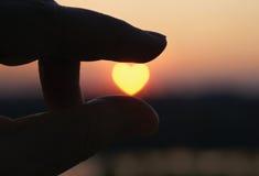 Corazón de la puesta del sol Fotos de archivo