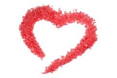 Corazón de la sal rosada del mar Foto de archivo