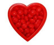 Corazón de la tarjeta del día de San Valentín con el caramelo Fotografía de archivo libre de regalías