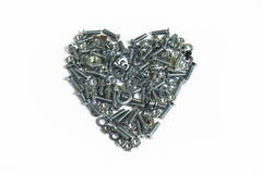 Corazón de la tarjeta del día de San Valentín de tornillos Fotos de archivo libres de regalías