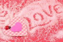 Corazón de la tela escocesa y símbolo rosados del amor Imagen de archivo