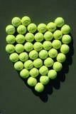 Corazón de las pelotas de tenis Imagenes de archivo