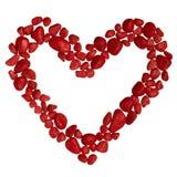 Corazón de las piedras rojas aisladas en el fondo blanco Fotografía de archivo libre de regalías