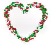 Corazón de los caramelos de chocolate de los colores de la Navidad foto de archivo