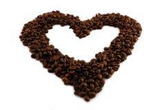 Corazón de los granos de café. Fotos de archivo