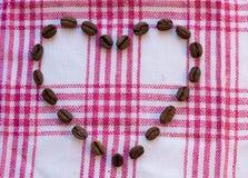 Corazón de los granos de café Imagen de archivo libre de regalías