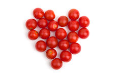 Corazón de los pequeños tomates de cereza Imagen de archivo libre de regalías