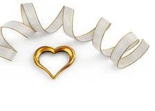 Corazón de oro adornado con una cinta Imagen de archivo