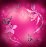 Corazón de orquídeas y de mariposas Foto de archivo libre de regalías