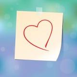 Corazón de papel sobre el vidrio Imagen de archivo