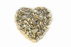 Corazón de piedras presentado en un fondo blanco Fotos de archivo