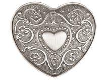 Corazón de plata en blanco Imagen de archivo