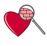 Corazón debajo de la lupa Fotos de archivo libres de regalías