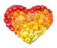 Corazón del arco iris de frutas y verduras Fotos de archivo