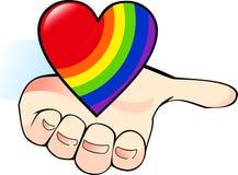 Corazón del arco iris en la palma Foto de archivo libre de regalías