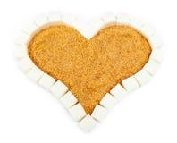 Corazón del azúcar. Aún-vida en un fondo blanco Imagen de archivo
