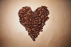 Corazón del café en el papel Foto de archivo