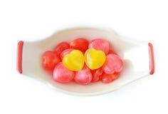 Corazón del caramelo en la taza Fotografía de archivo libre de regalías
