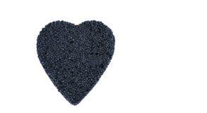 Corazón del caviar aislado en un blanco Foto de archivo