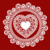 Corazón del cordón en fondo rojo Imagen de archivo libre de regalías