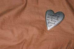 Corazón del estaño en la manta marrón Imágenes de archivo libres de regalías