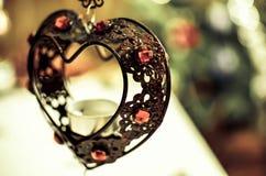 Corazón del hierro con las luces del Año Nuevo Imágenes de archivo libres de regalías