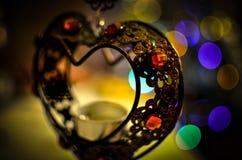 Corazón del hierro con las luces del Año Nuevo Fotografía de archivo libre de regalías