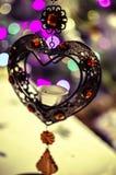 Corazón del hierro con las luces del Año Nuevo Foto de archivo