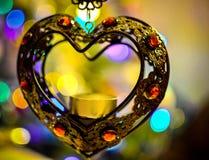 Corazón del hierro con las luces del Año Nuevo Imagen de archivo