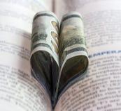 Corazón del libro de 100 dólares Fotografía de archivo libre de regalías