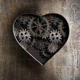 Corazón del metal con los engranajes oxidados Foto de archivo