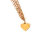 Corazón del oro en el encadenamiento, aislado en blanco Imagen de archivo