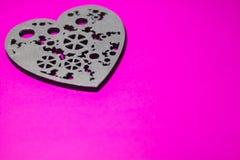 Corazón del vintage en un fondo púrpura Fotos de archivo