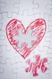 Corazón dibujado mano en un rompecabezas Fotografía de archivo libre de regalías