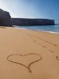 Corazón-dimensión de una variable sola de la playa en arena Fotografía de archivo libre de regalías
