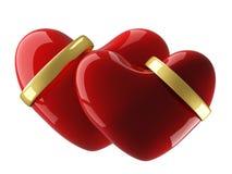 Corazón dos con los anillos de bodas. Fotos de archivo