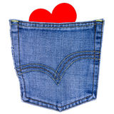 Corazón en bolsillo posterior de los pantalones vaqueros foto de archivo libre de regalías