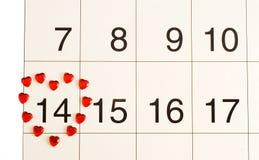 Corazón en el calendario Imagen de archivo