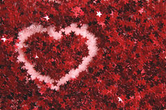 Corazón en estrellas rojas Imagenes de archivo